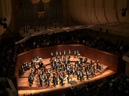 Photo of conductor bowing at the conclusion of a San Francisco Symphony performance